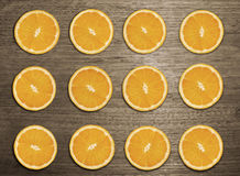 Orange slice on wood table. Arrange orange slice in unique pattern Royalty Free Stock Photos