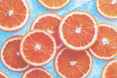Orange sliced on a blue rustic wood table, Popular healthy fruit Stock Images