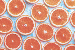 Orange sliced on a blue rustic wood table, Popular healthy fruit Royalty Free Stock Images