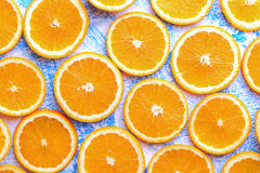 Orange sliced on a blue rustic wood table, Popular healthy fruit Royalty Free Stock Photo