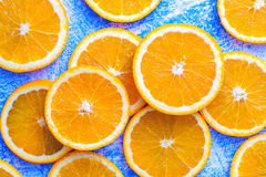 Orange sliced on a blue rustic wood table, Popular healthy fruit Stock Image