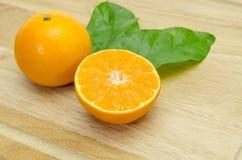 Orange sliced on chopping board background Stock Image