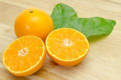 Orange sliced on chopping board background Stock Photo