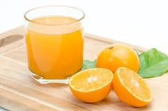 Orange sliced and orange juice on chopping board background Royalty Free Stock Photo