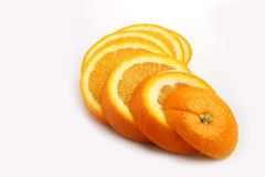 Orange slices. Arranged in a white background Stock Photography