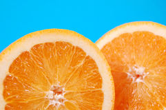 Orange Slices. Bright juicy oranges on a blue background royalty free stock image