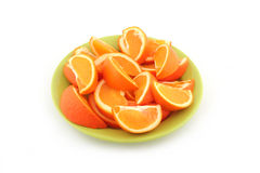 Orange slices. Fresh ripe orange slices on green plate isolated on white stock photo