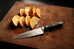 Orange slices. On wooden cutting board Royalty Free Stock Photos
