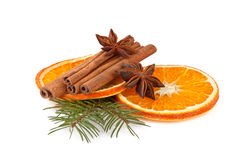 Orange slices, cinnamon with fir branch  on white Royalty Free Stock Photo