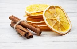 Orange slices with cinnamon on a light wooden background, enjoying the spices stock images