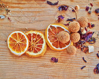 Orange slices, cinnamon rolls and other spices and grains. Dried orange slices, cinnamon rolls and other spices and grains on raw wooden table stock photos