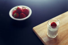 Orange slices dropped in crystal clear waterLow key shot of strawberry cream dessert Stock Photo