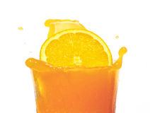 Orange slices fall in juice Royalty Free Stock Images