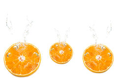 Orange. Slices falling deeply under water Stock Photo