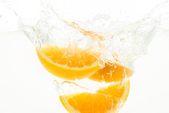 Orange Slices falling deeply under water with a big splash. Orange Slices, falling,water, splash,fruits Royalty Free Stock Photo