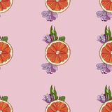 Orange slices with flowers seamless pattern on pink background stock illustration
