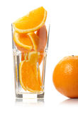 Orange and slices in glass Stock Image