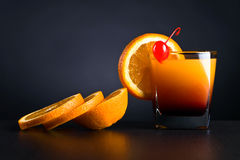Orange slices and glass of juice Stock Photos