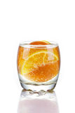 Orange slices in glass of water. Isolated on white background Royalty Free Stock Images