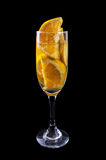 Orange slices on a glass on wine with dark Royalty Free Stock Image