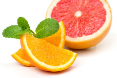 Orange slices and grapefruit and mint leaves. Juicy ripe orange slices and grapefruit and mint leaves Stock Photography