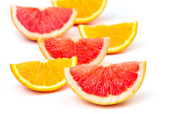 Orange slices and grapefruit slices. Juicy ripe orange slices and grapefruit slices on a white background Royalty Free Stock Photos
