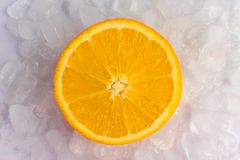 Orange slices are in the ice stock images