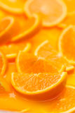 Orange slices in juice Royalty Free Stock Images