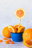 Orange slices in a mug. Fresh orange slices in blue enamel mug Royalty Free Stock Photography