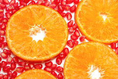 Orange slices pattern and pomegranate seed Stock Photos