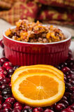 Orange slices on plate of cranberries Royalty Free Stock Image