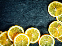 Orange slices on a slate background Royalty Free Stock Photos
