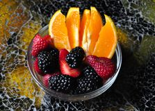 Orange slices, strawberries, and blackberries royalty free stock photos
