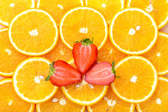 Orange slices with strawberry, background Royalty Free Stock Photography