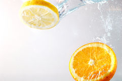 Orange slices in water. Orange thrown into water. High speed photography Royalty Free Stock Photography