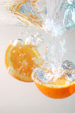 Orange slices in water Royalty Free Stock Images