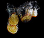 Orange slices in water Royalty Free Stock Photos