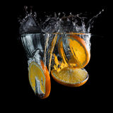 Orange slices in water Royalty Free Stock Image