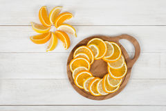Orange slices are well decorated on a cutting board. Stock Photography