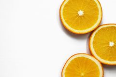 Orange slices on white background. Tropical bright juicy fruit vegetarian healthy diet flat lay banner. Art stock photos