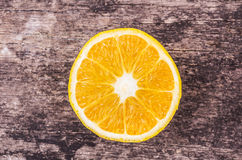 Orange slices on wood background Royalty Free Stock Photography