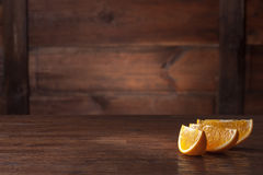 Orange slices on wood Royalty Free Stock Photography
