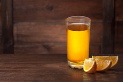 Orange slices on wood Stock Images