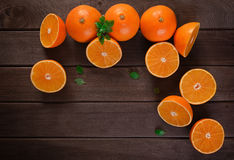 Orange slices on wooden table Royalty Free Stock Image