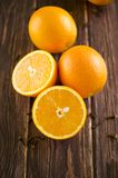 Orange slices are on a wooden table. Some orange slices are on a wooden table Stock Image
