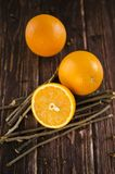 Orange slices are on a wooden table. Some orange slices are on a wooden table Royalty Free Stock Photos