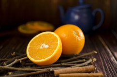 Orange slices are on a wooden table. Some orange slices are on a wooden table Royalty Free Stock Photo
