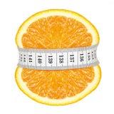 Orange slicewith measurement Royalty Free Stock Image