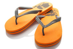 Orange slippers Stock Images