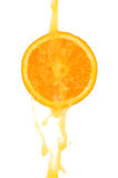 Orange sloce and juice splash Royalty Free Stock Images